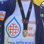 Medaille op logo